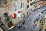 Street in Siena with parked scooters